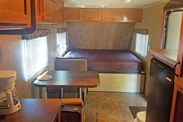 Standard RV rental interior seating and bed
